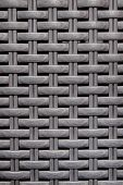 Black Wooden Striped Textured Basket Weaving Background.