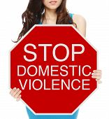 picture of abused  - A woman holding a conceptual stop sign on domestic abuse or violence - JPG