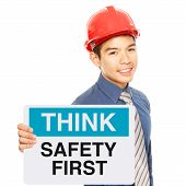 picture of workplace safety  - A man holding a sign with a safety message - JPG