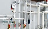 stock photo of valves  - new shiny industrial thermometer in boiler room - JPG
