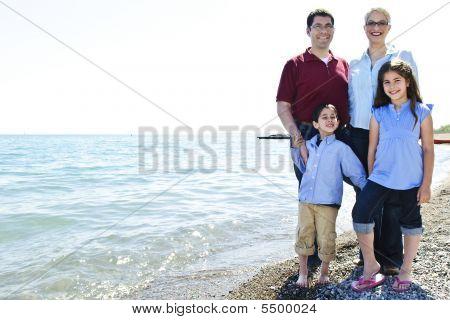 Happy Family At Beach