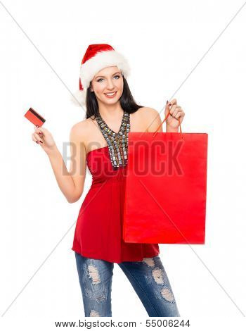 Young and beautiful Christmas shopper girl with the credit card isolated on white background
