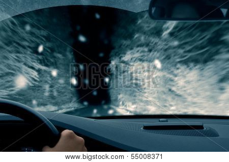 winter night driving - snowfall on a country road