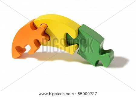 Three Interlocked Wooden Puzzle Pieces