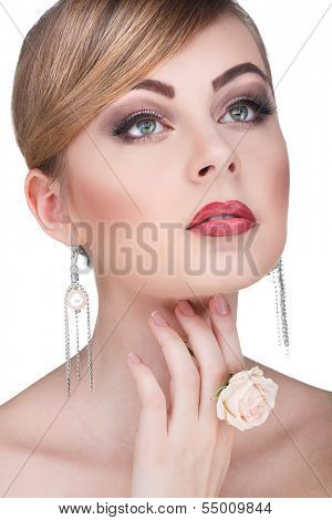 Closeup portrait of sexy whiteheaded young woman with beautiful blue eyes on white background