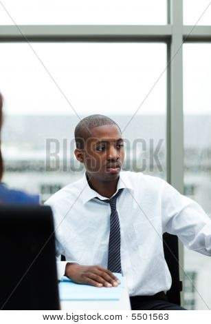 Young Afro-american Businessman In A Meeting