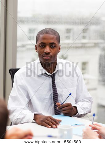 Afro-american Businessman Writing In An Office