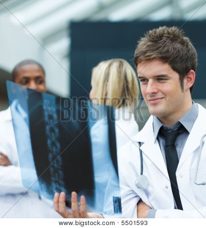 Young Doctor Looking At An X-ray