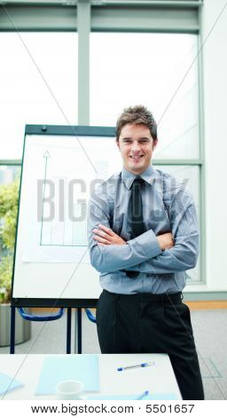 Smiling Young Businessman In Office