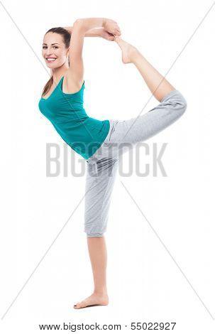 Woman in sportswear lifting leg in air