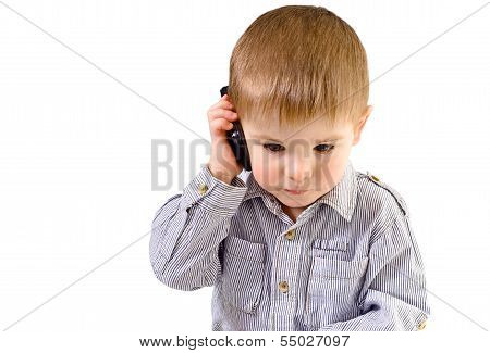 Beautiful small kid talking on a mobile phone