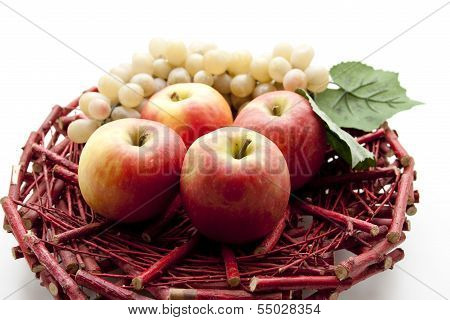 Fresh Red Apples with Grapes on Wooden Underlay