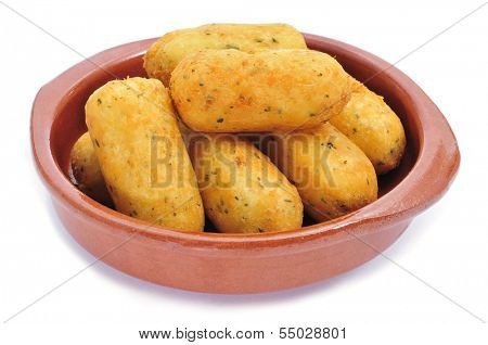 an earthenware bowl with croquetas de bacalao, spanish codfish croquettes, on a white background