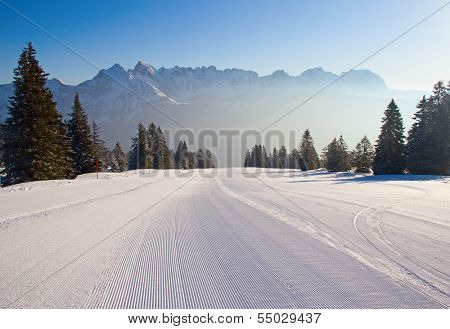 Early morning on slope on the skiing resort Flumserberg. Switzerland