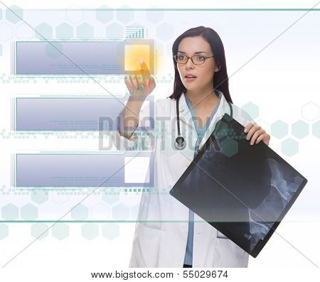 Young Doctor or Nurse with X-Ray Pushing Blank Button on Futuristic Translucent Panel - Ready For Your Own Copy.