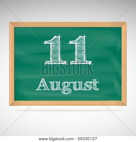 August 11, inscription in chalk on a blackboard