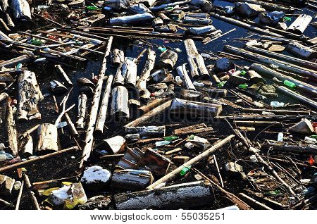 Water pollution in a lake with garbage