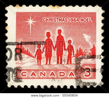 CANADA - CIRCA 1964: A Christmas stamp printed in Canada shows Family and Star of Bethlehem, circa 1964