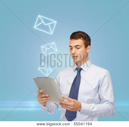 business, communication, modern technology and office concept - confident buisnessman with tablet pc and envelope