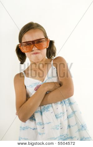 Young Girl Acting Tough With Sunglasses