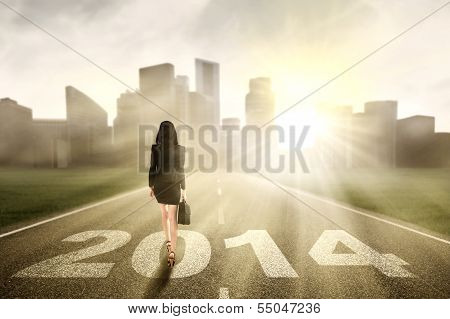 Businesswoman Walking To The New Year 2014