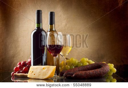 Wine, Grapes, Cheese And Sausage On Linen Background