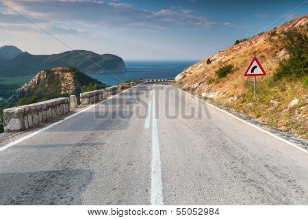 Dividing Line And Turn Sign On The Coastal Mountain Highway