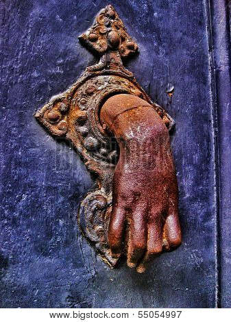Hand door knocker.