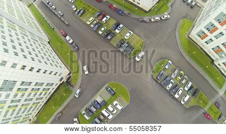 Parking with cars in modern residential complex. View from unmanned quadrocopter.