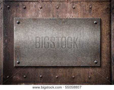 old metallic plate over rust metal background