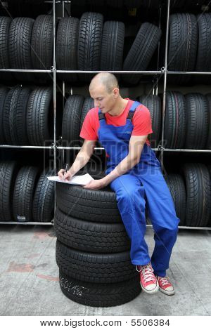 Working In A Tire Workshop