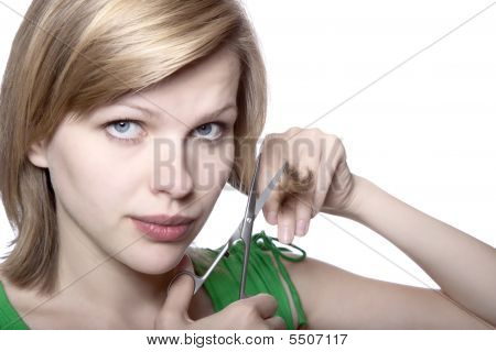 Girl Cutting Her Hair With Scissors