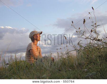Woman Sitting At Sunset