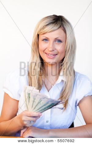 Smiling Businesswoman Holding Dollars