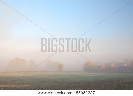 Misty Background With Houses