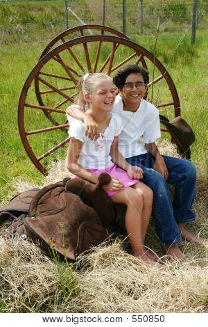 Boy And Girl On Hay