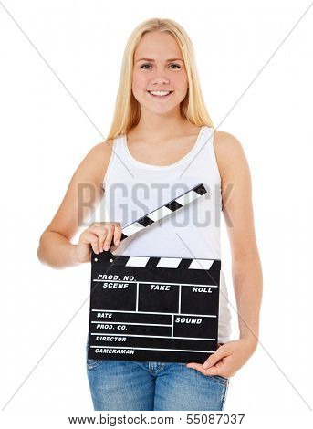 Attractive teenage girl with clapperboard. All on white background.