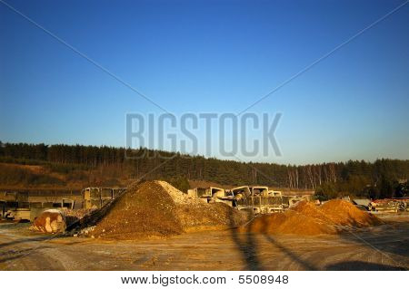 industrial Landscape With Building Gravel And Blue Sky