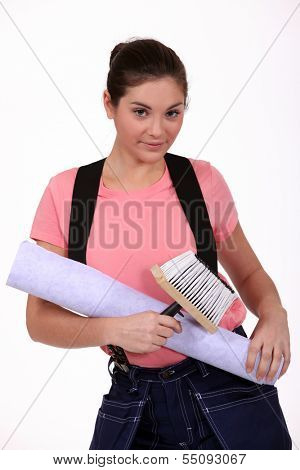 Woman holding wallpaper and paste