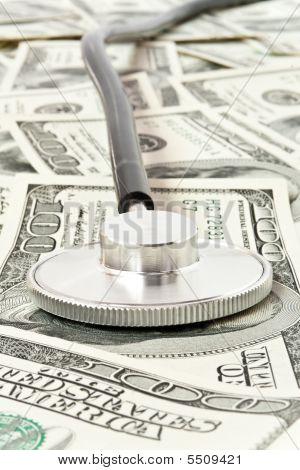 Stethoscope Over Money, Medicine Concept