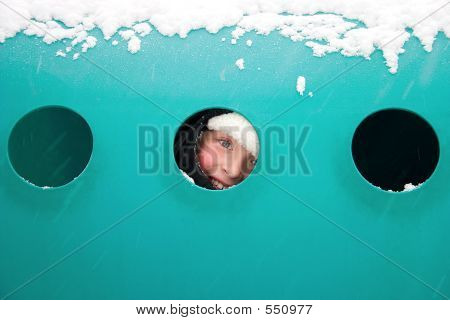 Boy Peeks Through Tunnel Window