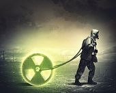 image of radioactive  - Man in respirator against nuclear background - JPG