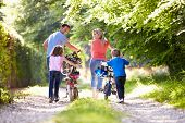 foto of 8-track  - Family Pushing Bikes Along Country Track - JPG