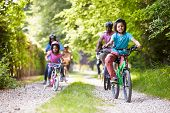 stock photo of 6 year old  - Multi Generation African American Family On Cycle Ride - JPG