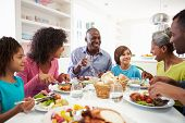 stock photo of granddaughter  - Multi Generation African American Family Eating Meal At Home - JPG