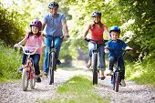 stock photo of 6 year old  - Family On Cycle Ride In Countryside - JPG