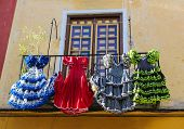 picture of traditional dress  - Traditional flamenco dresses at a house in Malaga Andalusia Spain - JPG