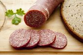 Fresh Smoked and Sliced Salami with Brown Bread on Edge Board