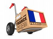 picture of free-trade  - Cardboard Box with Flag of France and Made in France Slogan on Hand Truck White Background - JPG
