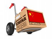 image of free-trade  - Cardboard Box with Flag of China and Made in China Slogan on Hand Truck White Background - JPG